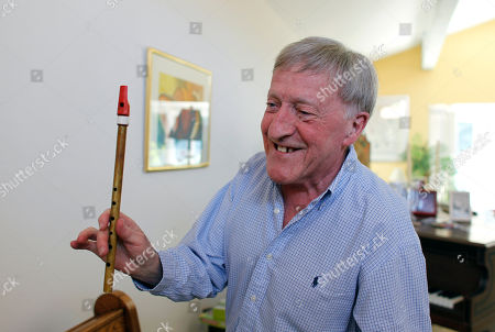 "Stock Image of Paddy Moloney Irish musician Paddy Moloney of the Chieftains, holds up a tin whistle at his home in Naples, Fla. Moloney collaborates with musicians, Bon Iver, the Pistol Annies, the Civil Wars, the Secret Sisters, the Carolina Chocolate Drops on The Chieftains' 50th anniversary album, ""Voice of Ages"