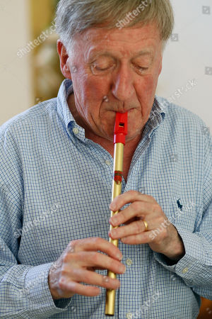 "Stock Photo of Paddy Moloney Irish musician Paddy Moloney of the Chieftains, plays a tin whistle at his home in Naples, Fla. Moloney collaborates with musicians, Bon Iver, the Pistol Annies, the Civil Wars, the Secret Sisters, the Carolina Chocolate Drops on The Chieftains' 50th anniversary album, ""Voice of Ages"
