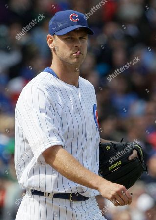 Kerry Wood Chicago Cubs relief pitcher Kerry Wood reacts after Washington Nationals' Adam LaRoche's single during the eighth inning of a baseball game in Chicago