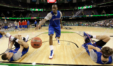 Kansas guard Tyshawn Taylor (10) warms up during a practice session for the NCAA Final Four basketball tournament, in New Orleans. Kansas plays Ohio State in a semifinal game on Saturday