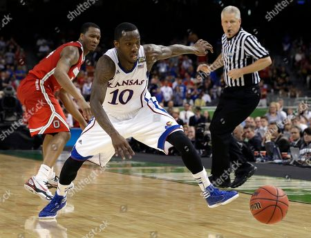 Kansas guard Tyshawn Taylor (10) chases a loose ball past Ohio State guard William Buford during the second half of an NCAA Final Four semifinal college basketball tournament game, in New Orleans