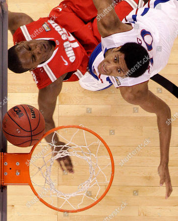 Ohio State forward Sam Thompson (12) and Kansas guard Tyshawn Taylor (10) go up against each other during the first half of an NCAA Final Four semifinal college basketball tournament game, in New Orleans