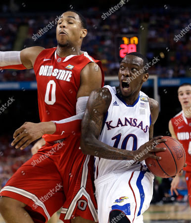 Kansas guard Tyshawn Taylor (10) drives against Ohio State forward Jared Sullinger (0) during the second half of an NCAA Final Four semifinal college basketball tournament game, in New Orleans