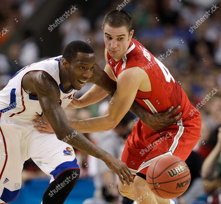 Kansas' Tyshawn Taylor drives past Ohio State's Aaron Craft, right, during the first half of an NCAA Final Four semifinal college basketball tournament game, in New Orleans