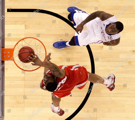 Ohio State guard William Buford (44) slam dunks over Kansas guard Tyshawn Taylor (10) during the second half of an NCAA Final Four semifinal college basketball tournament game, in New Orleans. Kansas won 64-62