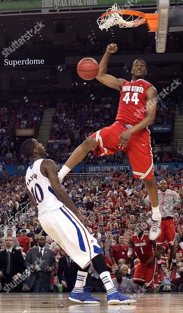 Ohio State guard William Buford (44) slam dunks over Kansas guard Tyshawn Taylor (10) during the second half of an NCAA Final Four semifinal college basketball tournament game, in New Orleans