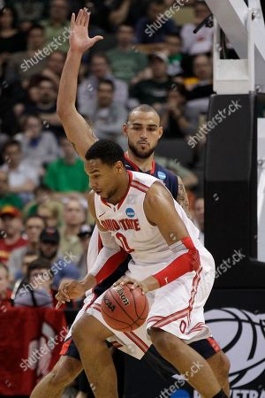 Jared Sullinger, Robert Sacre Ohio State's Jared Sullinger (0) dribbles around Gonzaga's Robert Sacre, rear, during the first half of an East Regional NCAA tournament third-round college basketball game in Pittsburgh, . Ohio State won 73-66