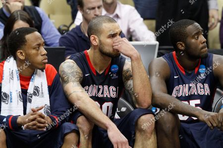 Robert Sacre, Marquise Carter, Gary Bell Gonzaga's Robert Sacre, right, Marquise Carter, left, and Gary Bell sit on the sidelines as time runs out in a 73-66 loss to Ohio State during an East Regional NCAA tournament third-round college basketball game in Pittsburgh