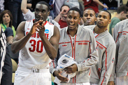 Robert Sacre, Marquise Carter, Gary Bell Ohio State's Evan Ravenel (30) begins to celebrate with teammates on the sidelines as time runs out in a 73-66 win over Gonzaga during an East Regional NCAA tournament third-round college basketball game in Pittsburgh