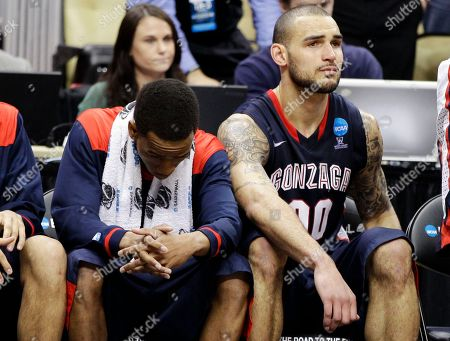 Robert Sacre, Marquise Carter Gonzaga's Robert Sacre, right, and Marquise Carter sit on the sidelines as time runs out in a 73-66 loss to Ohio State during an NCAA tournament third-round college basketball game in Pittsburgh