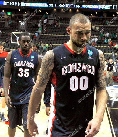 Robert Sacre, Sam Dower Gonzaga's Robert Sacre (0) and Sam Dower (35) walk off the court after losing 73-66 to Syracuse in an NCAA tournament third-round college basketball game on in Pittsburgh