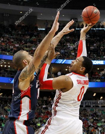 Jared Sullinger, Robert Sacre Ohio State's Jared Sullinger (0) shoots over Gonzaga's Robert Sacre in the second half of an NCAA tournament third-round college basketball game on in Pittsburgh. Ohio State won 73-66