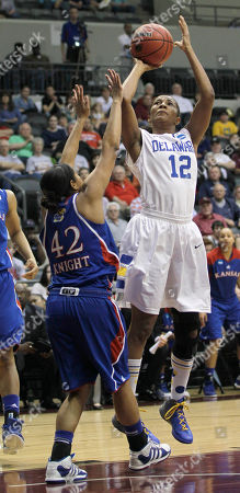 Danielle Parker, Natalie Knight Delaware's Danielle Parker (12) goes up over Kansas' Natalie Knight (42) during first half of an NCAA tournament second-round women's college basketball game in Little Rock, Ark