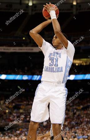 John Henson North Carolina Tar Heels' John Henson (31) shoots against the Kansas Jayhawks during the first half of the NCAA men's college basketball tournament Midwest Regional final, in St. Louis
