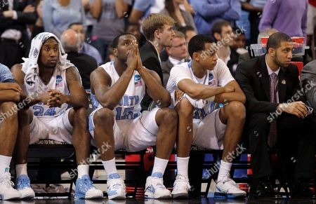 Justin Watts, P.J. Hairston, John Henson, Kendall Marshall North Carolina guard Justin Watts, guard P.J. Hairston, forward John Henson and guard Kendall Marshall, from left, watch during the second half of the NCAA men's college basketball tournament Midwest Regional final, in St. Louis. Kansas won 80-67