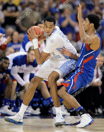 John Henson, Kevin Young North Carolina Tar Heels' John Henson (31) is defended by Kansas Jayhawks' Kevin Young (40) during the first half of the NCAA men's college basketball tournament Midwest Regional final, in St. Louis