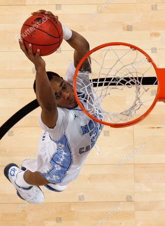 John Henson North Carolina forward John Henson goes up for a basket during the second half of the NCAA men's college basketball tournament Midwest Regional final against Kansas, in St. Louis