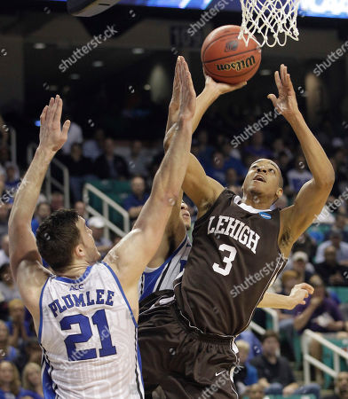 C.J. McCollum, Miles Plumlee Lehigh's C.J. McCollum (3) shoots over Duke's Miles Plumlee (21) during the first half of an NCAA tournament second-round college basketball game in Greensboro, N.C