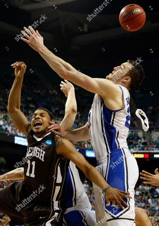 Stock Photo of Mackey McKnight Duke's Miles Plumlee, right, and Lehigh's Mackey McKnight (11) reach for a rebound during the second half of a South Regional NCAA tournament second-round college basketball game in Greensboro, N.C., . Lehigh won 75-70