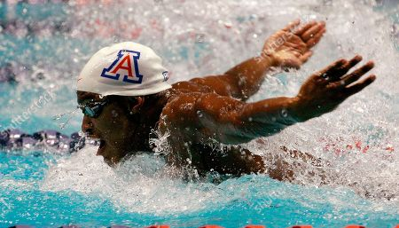 Giles Smith Arizona's Giles Smith swims the butterfly leg of the 200 yard medley relay at the NCAA men's swimming and diving championships, in Federal Way, Wash. Arizona won the race