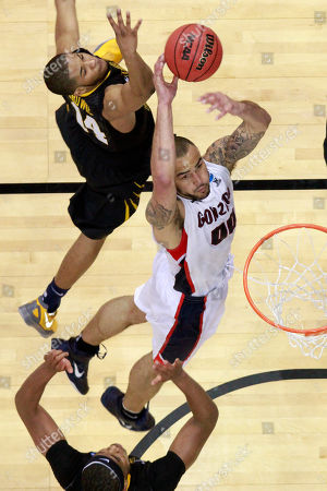 Gary Browne, Robert Sacre, Kevin Jones Gonzaga's Robert Sacre (00) puts up a shot between West Virginia's Gary Browne, left top, and Kevin Jones, bottom during the first half of an East Regional NCAA tournament second-round college basketball game in Pittsburgh, . Gonzaga won 77-54
