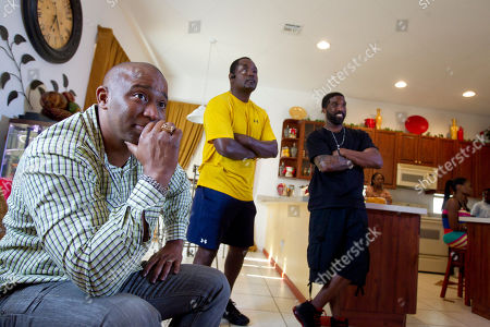 Carter Eve Sr., James Robinson, Jermone Horton Carter Eve Sr., left, James Robinson and Jerome Horton react as they listen, in Miramar, Fla., as special prosecutor Angela Corey announced George Zimmerman, the neighborhood watch volunteer who shot 17-year-old Trayvon Martin had been arrested and charged with second-degree murder Wednesday after months of mounting tensions and protests across the country. Horton was Martin's coach