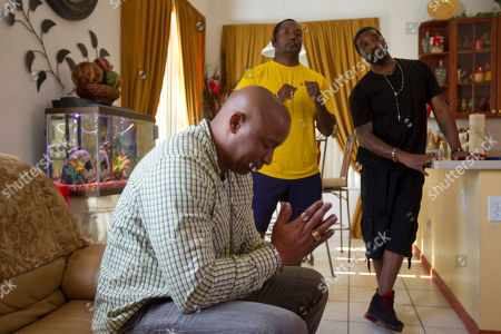 Carter Eve Sr., James Robinson, Jermone Horton Carter Eve Sr. offers a blessing as he and fellow Martin family friends, James Robinson and Jerome Horton listen, in Miramar, Fla., as special prosecutor Angela Corey announced George Zimmerman, the neighborhood watch volunteer who shot 17-year-old Trayvon Martin had been arrested and charged with second-degree murder Wednesday after months of mounting tensions and protests across the country. Horton was Martin's coach