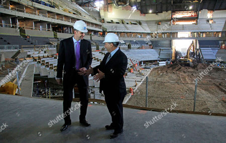 Mikhail Prokhorov, left, Russian billionaire and owner of the New Jersey Nets basketball team, and Bruce Ratner, developer of the Barclays Center arena, speak during a news conference on at the arena's construction site in the Brooklyn borough of New York