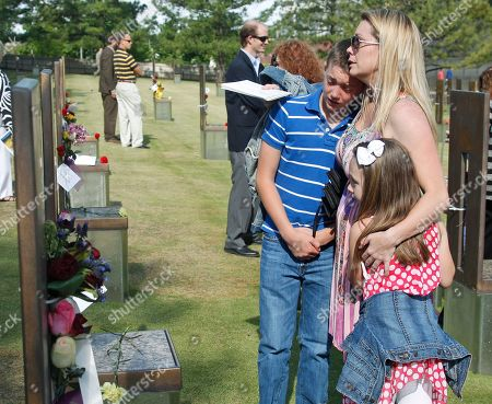 Jennifer Walker Jennifer Walker, center, of Ardmore, Okla., stands at the chair of her father, David Jack Walker, in the Field of Chairs at the Oklahoma City National Memorial and Museum, following the 17th annual Remembrance Ceremony in Oklahoma City, . With her are her two children, Walker, left, named for her father, and Graecin, right