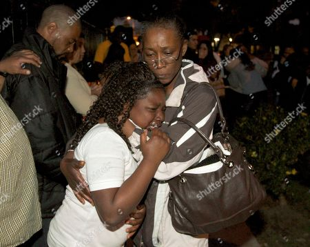 Felicia Taylor Felicia Taylor, right, an aunt of Kendrec McDad, consoles a member of the McDade family, as they mourn Kendrec McDade, a 19-year-old Citrus College student at a memorial in Pasadena, Calif. on . McDade was shot by police after being chased and making a move, reaching into his waistband, according to police. The police were chasing McDade, believing him to be one of two thieves who had just robbed Oscar Carrillo, who had told police that McDade was armed