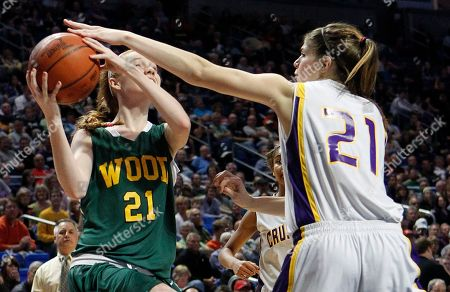 Colleen Young, Emily Martin Archbishop Wood's Colleen Young, left, tries to shoot around Lancaster Catholic's Emily Martin in the second half of the PIAA class AAA girls state championship basketball game, in State College, Pa. Archbishop Wood won 52-33