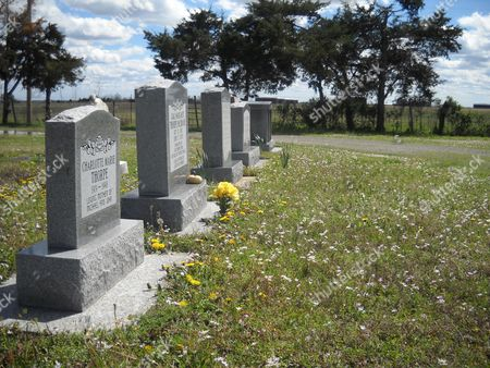 In this photograph made, several Sac and Fox Nation members, including Iva Thorpe, the first wife of legendary Indian athlete Jim Thorpe, are buried in this Catholic cemetery near a Cushing, Okla., oil tank farm. The nation's chief, George Thurman, fears a pipeline from Cushing to the Texas Gulf Coast will disturb unmarked Indian burial grounds while cutting through tribal lands