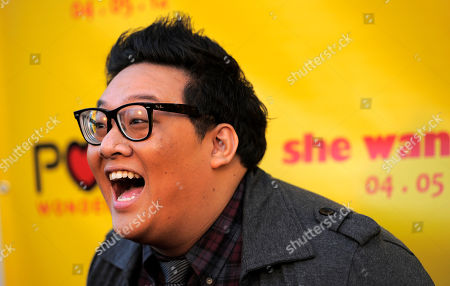 "Daniel Nguyen Daniel Nguyen, a cast member in ""She Wants Me,"" reacts to photographers at the premiere of the film in Beverly Hills, Calif"