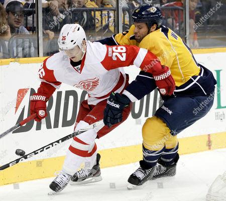 Jiri Hudler, Shea Weber Detroit Red Wings left wing Jiri Hudler (26), of Czech Republic, and Nashville Predators defenseman Shea Weber, right, chase the puck in the first period of an NHL hockey game, in Nashville, Tenn