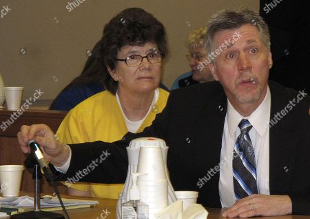 Lori Phillips, left, consults with her attorney Andrew Lambert in court, in Anchorage, Alaska. Phillips, a repeat drunken driver, was sentenced Friday to 20 years in prison for the 2009 death of Louis Clement. Prosecutors said Phillips consumed an estimated 18 drinks before driving her SUV the wrong way down a highway and slamming into Clement's sedan