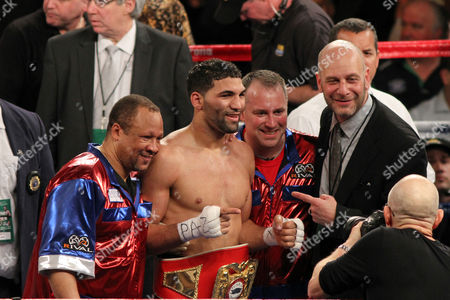 Edwin Rodriguez, Ronnie Shields, Lou DiBella Edwin Rodriguez celebrates a win against Don George after his bout, in New York. Trainer Ronnie Shields on far L, Promoter Lou DiBella on far R. Rodriguez won via 10-round unanimous decision