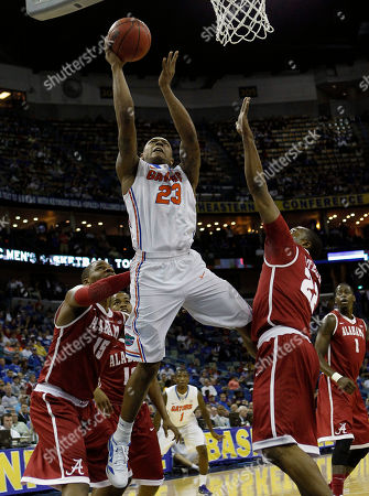 Bradley Beal, Nick Jacobs, Andrew Steele Florida guard Bradley Beal (23) shoots between Alabama forward Nick Jacobs (15) and guard Andrew Steele (22) during the first half of an NCAA college basketball game in the second round of the Southeastern Conference tournament at the New Orleans Arena in New Orleans