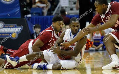 Erving Walker, Trevor Lacey, Andrew Steele Florida guard Erving Walker (11) fights for a loose ball with Alabama guard Trevor Lacey, left, and Alabama guard Andrew Steele (22) during the second half of an NCAA college basketball game in the second round of the Southeastern Conference tournament at the New Orleans Arena in New Orleans