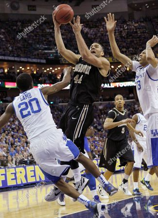Vanderbilt forward Jeffery Taylor (44) shoots over Kentucky guard Doron Lamb (20) and forward Terrence Jones (3) during the first half of an NCAA college basketball game in the championship game of the 2012 Southeastern Conference tournament at the New Orleans Arena in New Orleans
