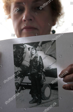 """Stock Image of Andrea Talbutt Andrea Talbutt holds a photo of her """"Uncle Mike"""" at her home in Elmsford, N.Y., . Talbott and her other two Bronx-born sisters in their 60's are preparing to embark on a South Pacific odyssey that's more pilgrimage than vacation: They're headed to the remote jungle crash site of what's believed to be their late uncle's World War II fighter plane"""