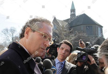 Stock Image of John Witherow, Marie Colvin John Witherow, editor of the Sunday Times, talks with reporters after attending the funeral service for journalist Marie Colvin, at St. Dominic Roman Catholic Church in Oyster Bay, N.Y. The 56-year-old Colvin was a longtime reporter for Britain's Sunday Times. She and French photographer Remi Ochlik were killed Feb. 22 in shelling in Homs, Syria