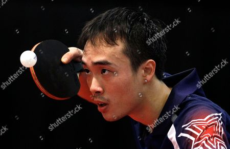 Stock Photo of Timothy Wang United States' Timothy Wang serves a shot against compatriot Adam Hugh during a men's semifinal match of the North America 2012 Olympic Games table tennis qualifying tournament in Cary, N.C., . Wang won to advance to the final