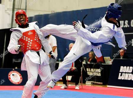 Terrence Jennings, Mark Lopez Terrence Jennings, of Alexandra, Va., left, reacts after flipping Mark Lopez, of Sugar Land, Texas, off his feet during their second meeting in a men's 68-kilogram division Olympic team trials taekwondo match, at the U.S. Olympic Training Center in Colorado Springs, Colo