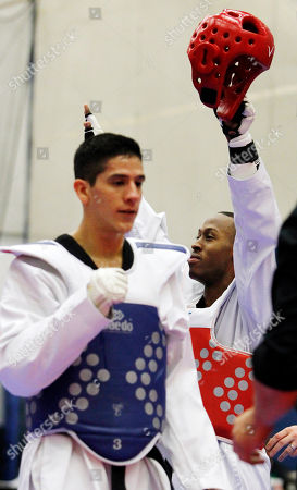 Terrence Jennings, Mark Lopez Terrence Jennings, of Alexandra, Va., back, reacts after defeating Mark Lopez, of Sugar Land, Texas, during their men's 68-kilogram division Olympic team trials taekwondo match, at the U.S. Olympic Training Center in Colorado Springs, Colo