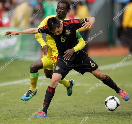 Hector Herrera, Saliou Ciss Mexico's Hector Herrera (6) and Senegal's Saliou Ciss scramble for the ball during an under-23 friendly soccer match, in San Francisco
