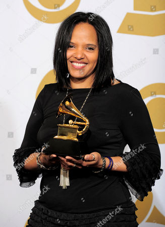 """Terri Lyne Carrington Terri Lyne Carrington poses backstage with the award for best jazz vocal album for """"The Mosaic Project"""" at the 54th annual Grammy Awards on in Los Angeles"""