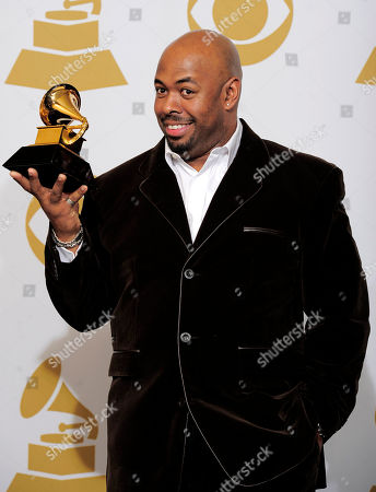 """Christian McBride Christian McBride, of the Christian McBride Big Band, poses backstage with the award for best large jazz ensemble for """"The Good Feeling"""" at the 54th annual Grammy Awards on in Los Angeles"""