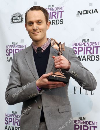 Stock Photo of Will Reiser Will Reiser poses with the best first screenplay award for 50/50 at the Independent Spirit Awards, in Santa Monica, Calif