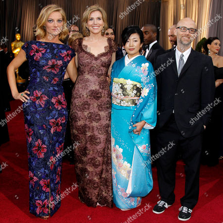 Stock Photo of Lucy Walker, Kira Carstensen, Moby Lucy Walker, left, Kira Carstensen, second from left, and Moby, right, arrive before the 84th Academy Awards, in the Hollywood section of Los Angeles