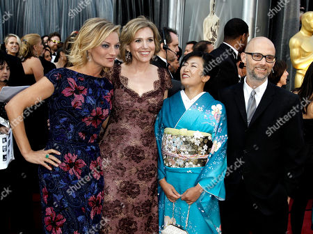 Stock Image of Lucy Walker, Kira Carstensen, Moby Lucy Walker, left, Kira Carstensen, second from left, and Moby, right, arrive before the 84th Academy Awards, in the Hollywood section of Los Angeles